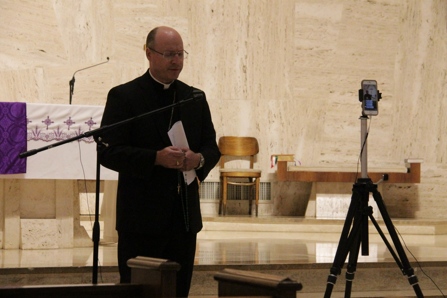 Bishop W. Shawn McKnight leads the praying of one of the decades during a livestreamed Rosary in the Cathedral of St. Joseph.