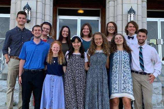 This year's Totus Tuus missionaries for the Jefferson City diocese gather on the steps of St. Pius X Church in Moberly.