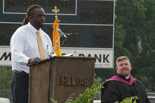 Victor Bell, a teacher and coach at Helias Catholic High School delivers the keynote address to the Helias Catholic Class of 2020 during commencement exercises June 19 at the Crusader Athletic Complex.