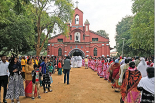 Hundreds line up for a Confirmation Mass with Bishop W. Shawn McKnight in St. Joseph Church in Tapkara, in the Diocese of Jashpur, India.