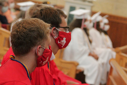 Members of Sacred Heart High School's Class of 2020 listen to the homily during their Baccalaureate Mass on July 25 in St. Vincent de Paul parish's Sacred Heart Chapel in Sedalia.