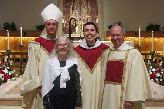 Father James Puglis (center) of the Franciscan Friars of the Third Order (TOR) joins his parents, Mary Ann and Deacon Joseph Puglis of Our Lady of Lourdes parish in Columbia and Bishop Mark L. Bartchak of Altoona-Johnstown in the chapel of St. Francis College in Loretto, Pennsylvania. It is June 10, 2017, the day of Fr. Puglis's priestly ordination.