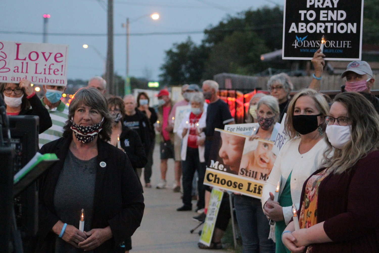 About 60 people take part in a kickoff rally and candlelight prayer vigil on the sidewalk outside Planned Parenthood on Sept. 22, to mark the beginning of the Columbia 40 Days of Life fall campaign.