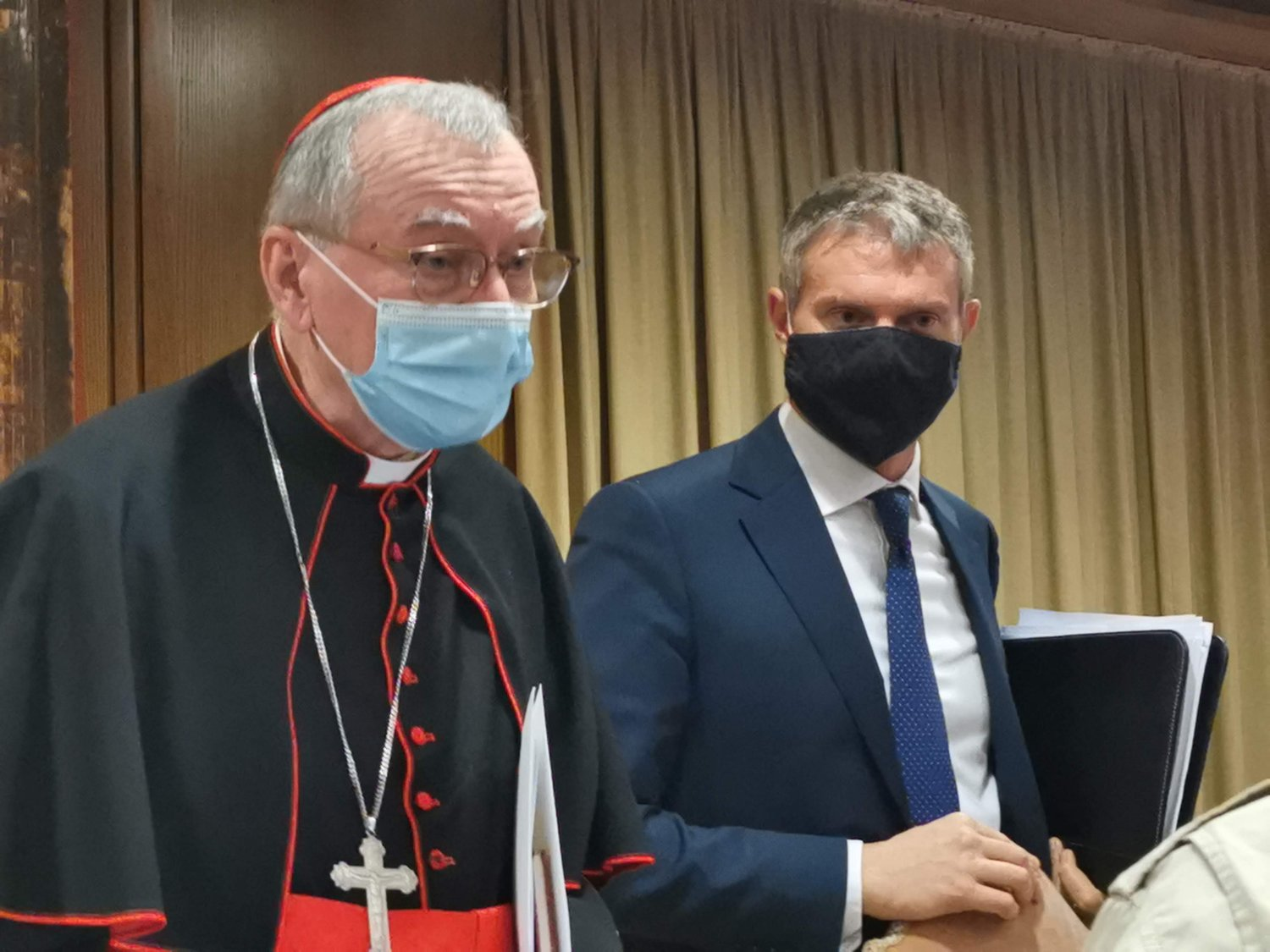 "Cardinal Pietro Parolin, Vatican secretary of state, and Matteo Bruni, director of the Vatican Press Office, are pictured during a press conference for the release of Pope Francis' new encyclical, ""Fratelli Tutti, on Fraternity and Social Friendship,"" in the synod hall at the Vatican Oct. 4, 2020."