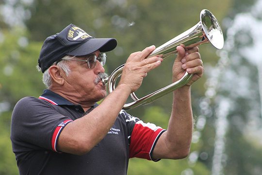 "A bugler from Amarillo, Texas, plays ""Taps"" in honor of the fallen and their families."