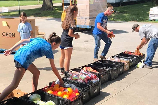 Young people from Immaculate Conception parish in Brookfield help distribute food at a local food pantry as part of the CHRISTpower Challenge, held this summer in lieu of the traditional CHRISTpower diocesan service retreat. Youth ministry is having a renaissance in parts of northern Missouri with help from diocesan ministries funded by the Catholic Stewardship Appeal.
