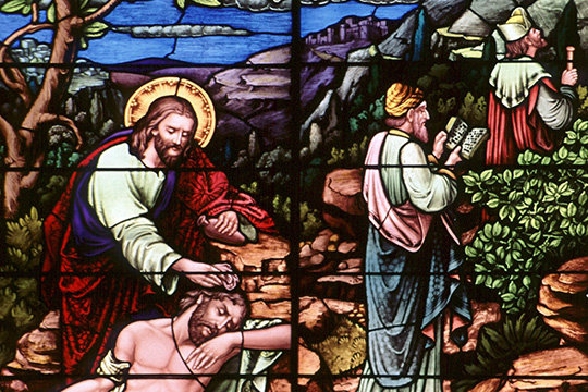 "A stained glass window at Sacred Heart Church in Freeport, Minn., depicts the good Samaritan. The 2,000-year-old parable of the Good Samaritan is the anchor of the encyclical ""Fratelli Tutti, on Fraternity and Social Friendship."""