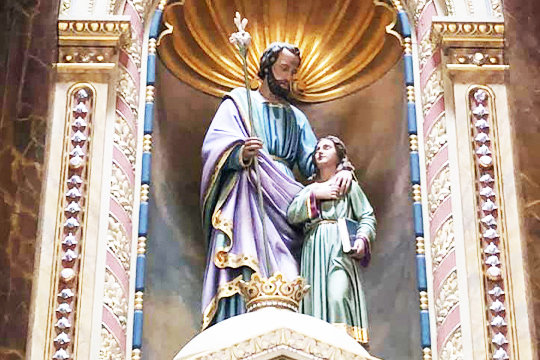 This image of St. Joseph and the child Jesus adorns the reredos above the Altar of Answered Prayers in the Shrine of St. Joseph in St. Louis.