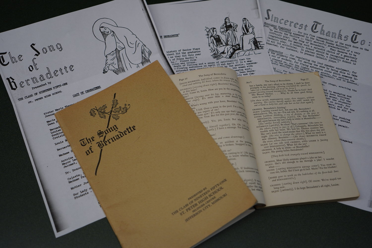 "Pages from the St. Peter High School's 1951 yearbook, the program and a marked-up script are reminders of the senior class production of ""The Song of Bernadette"" 70 years ago this spring. The three-act play, based on a novel and motion picture of the same name, told the story of St. Bernadette and Our Lady's miraculous apparitions to her near the town of Lourdes, France."