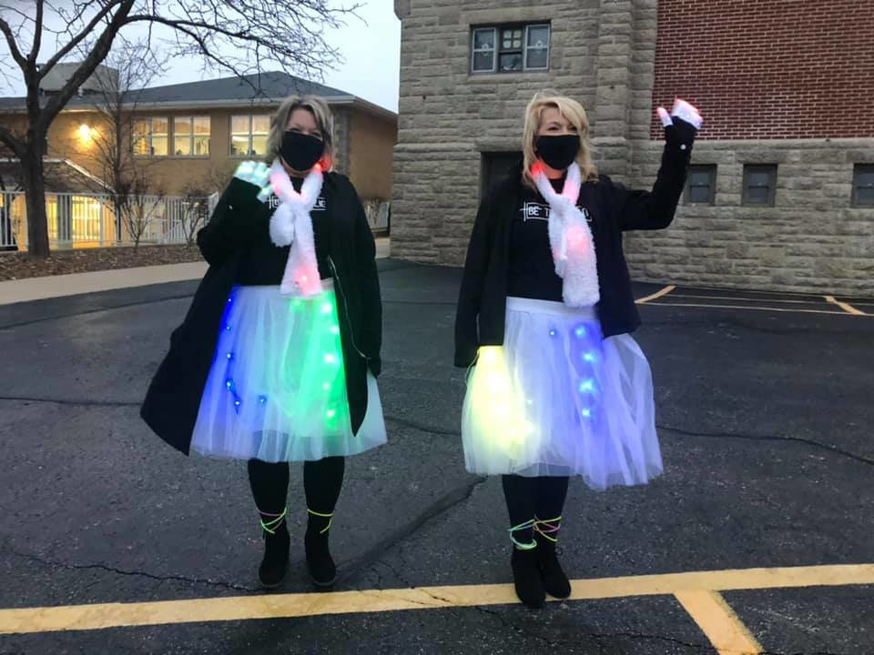 "Fourth-grade teacher Mandi Steinlage and fifth-grade teacher Connie Andrews of St. Stanislaus School in Wardsville sport their ""Be a Light"" attire on the Tuesday of Catholic Schools Week."