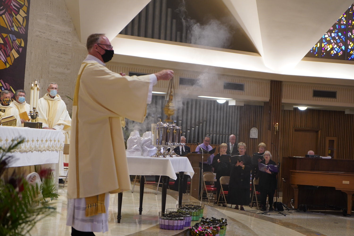 Deacon John Schwartze incenses the congregation during the Chrism Mass on March 30, 2021, in the Cathedral of St. Joseph in Jefferson City.