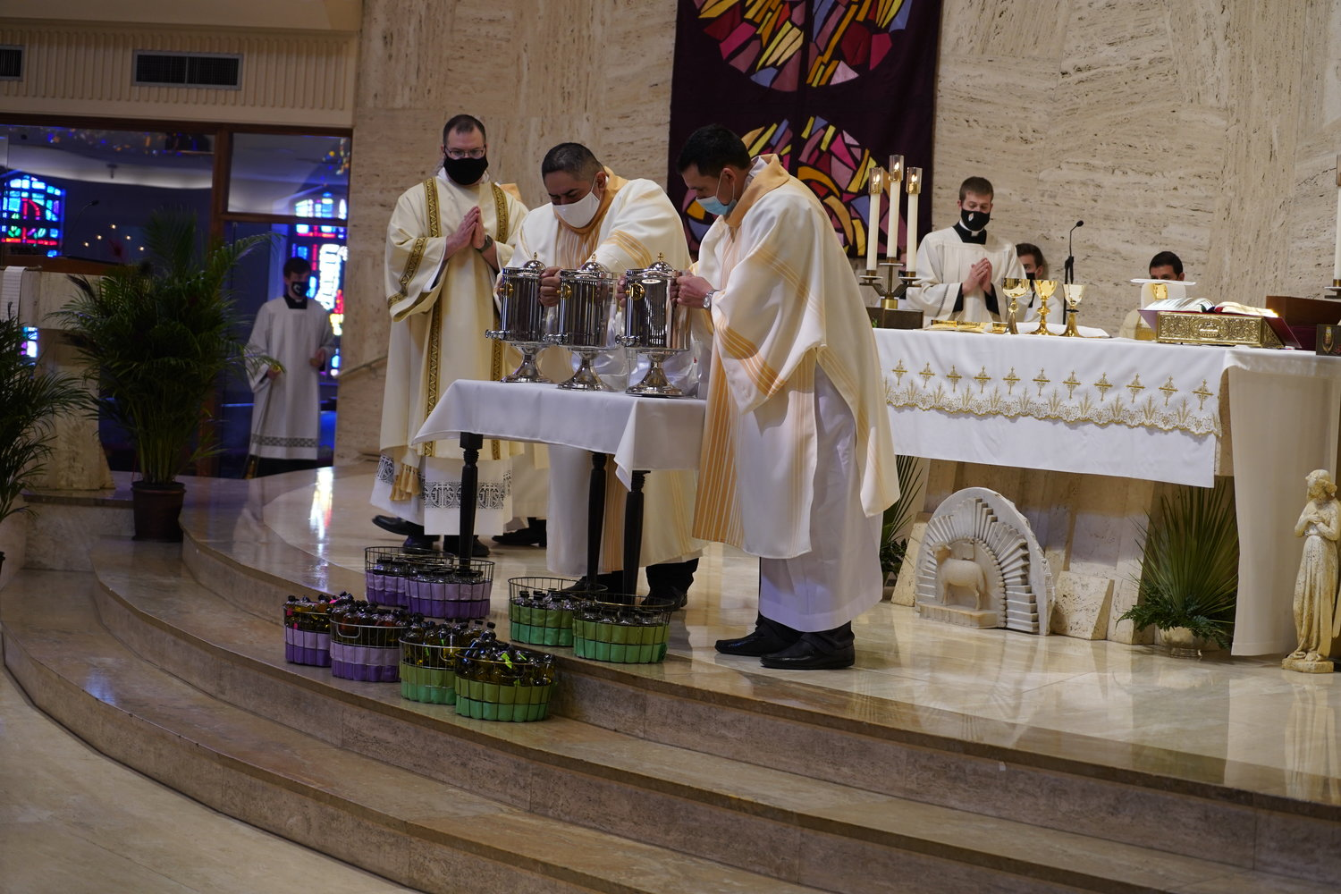 Rev. Mr. Derek Hooper observes Deacon Louis Reyes and Deacon Santos Rubio presenting the Oil of Catechumens and the Oil of the Sick during the Chrism Mass March 30 in the Cathedral of St. Joseph.