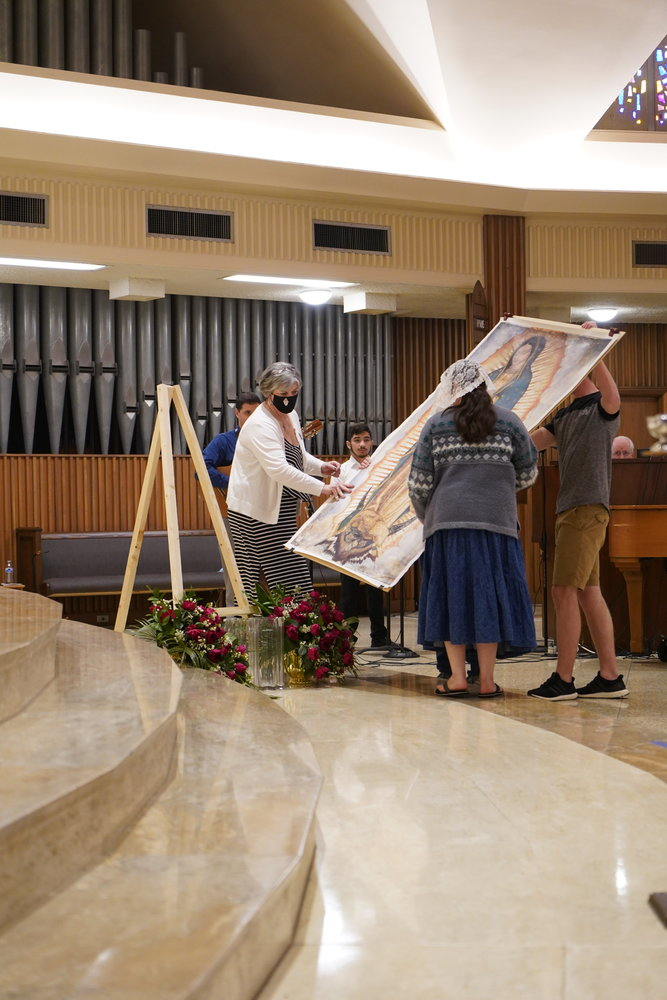 People carry the image of Our Lady of Guadalupe in procession before Mass.