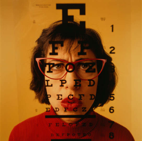 Woman wearing glasses having eye test