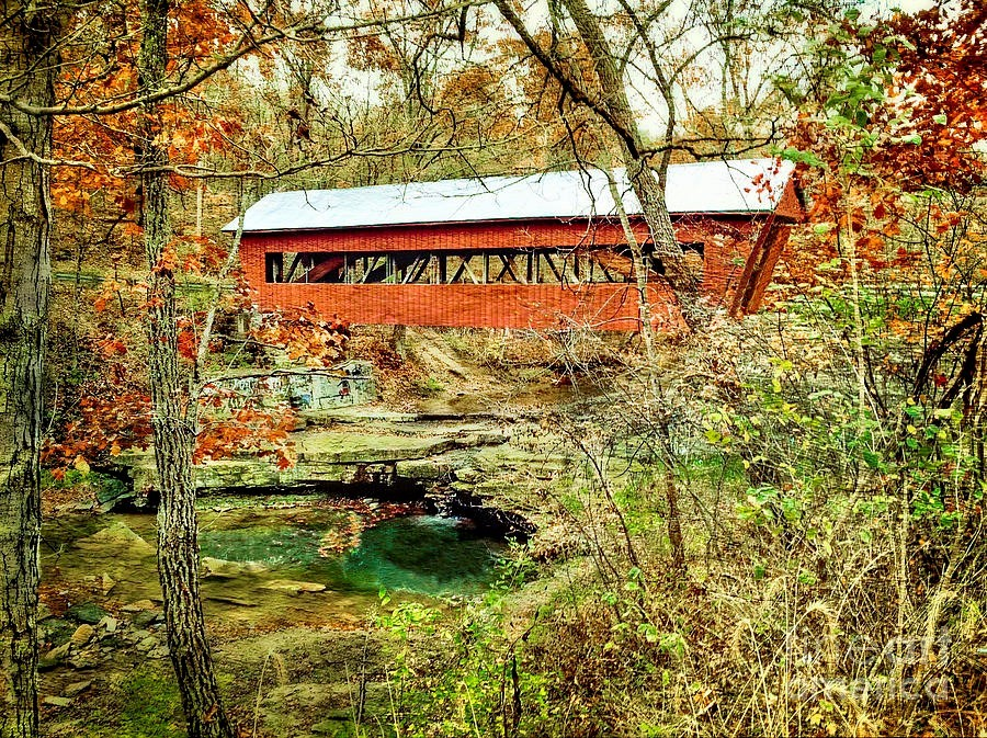 In the beautiful sunlight of an autumnal day, the historic Helmick Mill is open for traffic and for people to cross, it serves as one of the five covered bridges in Morgan County that are accessible for driving over the river.