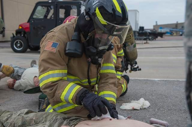 U.S. Air Force Senior Airman Dylan Rousseau, a fire protection member assigned to the 97th Civil Engineer Squadron, performs Emergency Medical Technician (EMT) procedures on a victim of a simulated chemical attack, Dec. 6, 2018, at Altus Air Force Base, Okla. EMT training is a requirement for fire protection members and practiced during a simulated aftermath of an emergency medical situation.