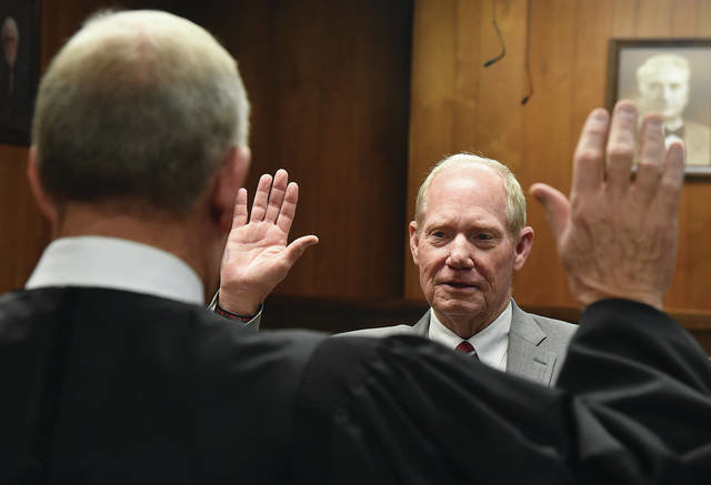 Former Oklahoma Supreme Court Justice Joseph Watt, foreground, swears in Oklahoma 3rd Judicial District Attorney David Thomas Monday in the Jackson County Courthouse. Thomas won the election in November. Watt was an Altus City Attorney and District 3 Judge before becoming a Supreme Court Justice in 1992.