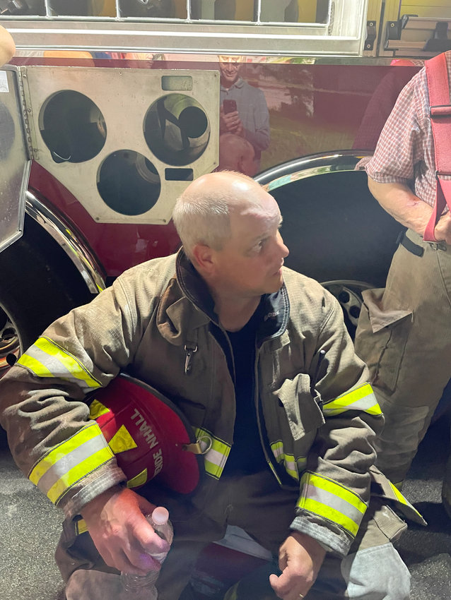 Clinton Fireman Lt. Ryan Mendenhall speaking to the firemen at the Carter Street fire incident. The fire was quickly contained; the incident cause is under investigation.