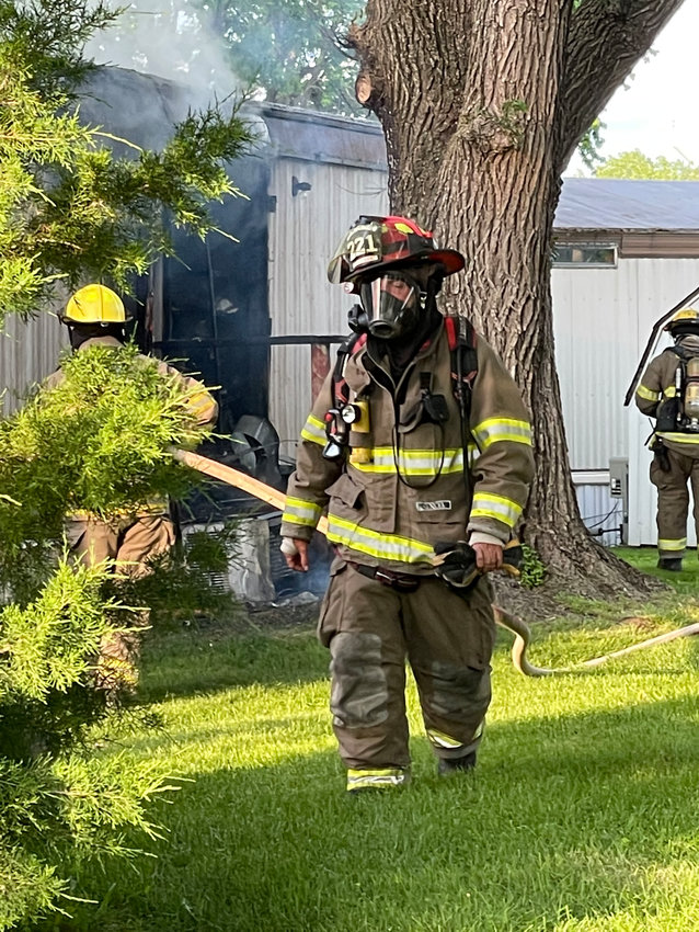 Clinton Fireman Mitch Grimes at the fire at the 900 block of North 3rd St. (June 1)