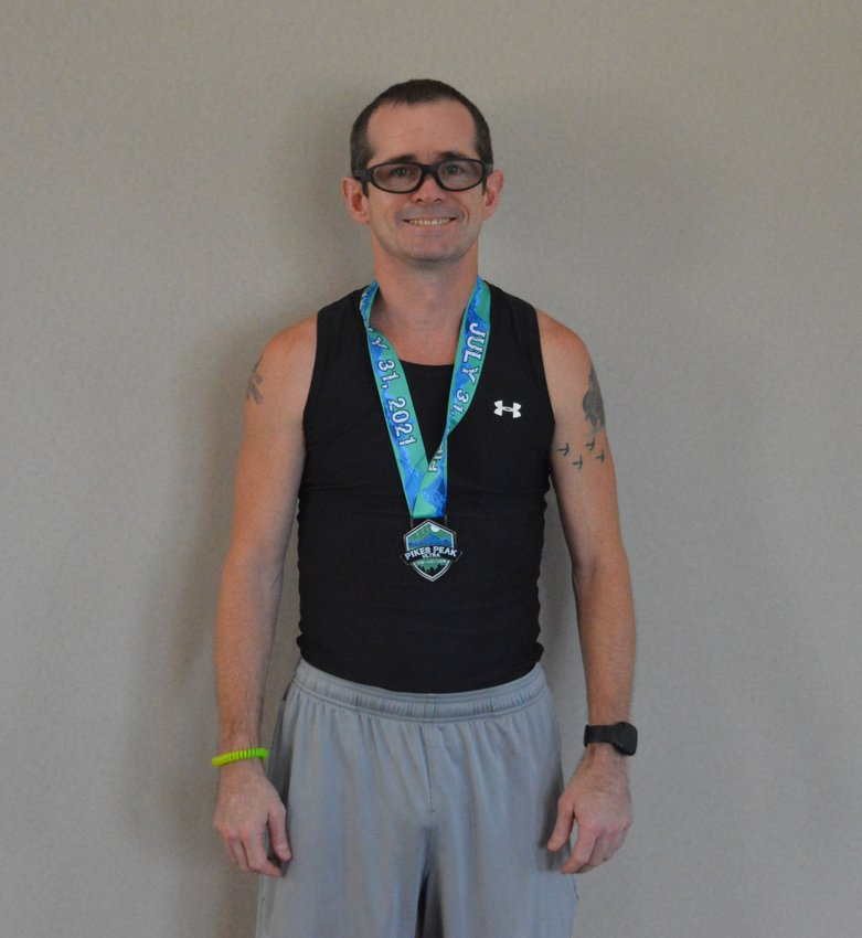 WILLIE TICHENOR showing off his Ultra Marathon Medal he won in the Pikes Pike 50 mile race. 50 miles, that is not a type-o. Take time to read his story.
