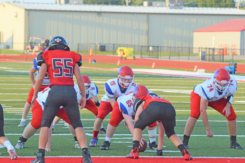 COLLIN BERRY under center led the Cards to a 24-20 win over Odessa. The Cards' center is Andy Vandenberg. Big #74 is Isaac Tennal.