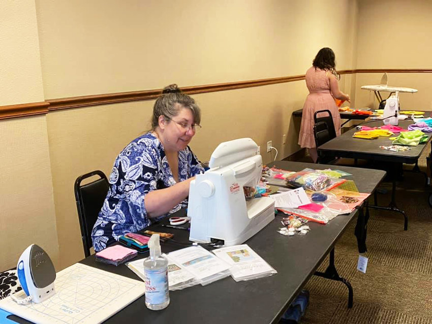 SEWING AWAY on Friday was Jody Anderson, as she attended classes offered at this year's Quilt Walk held downtown.