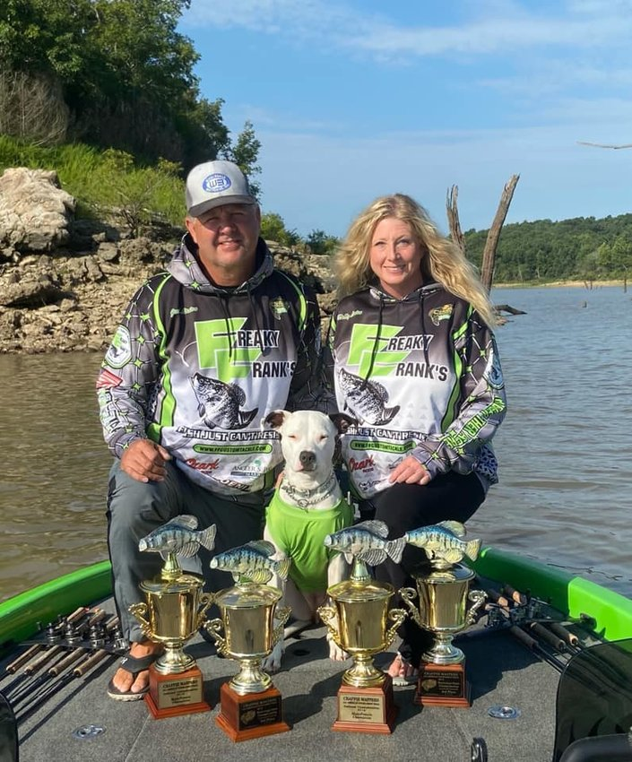 THE LINTONS showing off some of their 2021 Crappie Masters trophies. I wonder if their dog is a part of the team?