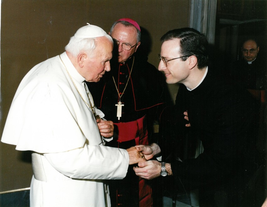 Father (now Bishop) W. Shawn McKnight greets Pope St. John Paul II.