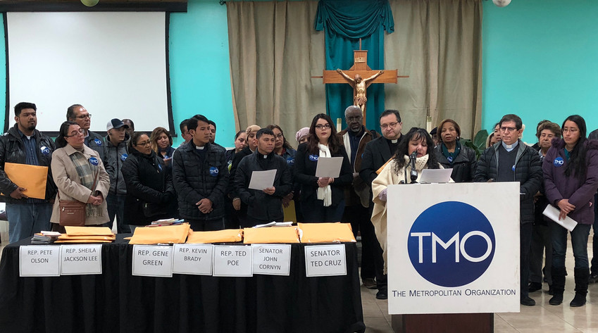 Recipients of the Deferred Action for Childhood Arrivals program and their supporters, including clergy, participate in a Jan. 18 news conference sponsored by the Metropolitan Organization at St. Leo the Great Catholic Church in Aldine, Texas. They gathered thousands of postcards to be mailed to congressional members urging they keep the DACA program intact.
