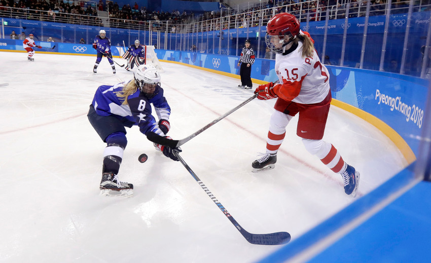 Emily Pfalzer of the U.S. women's hockey team battles for the puck against Valeria Pavlova of Olympic Athletes Russia during the 2018 Winter Olympics in Gangneung, South Korea. Pfalzer is a graduate of Boston College.