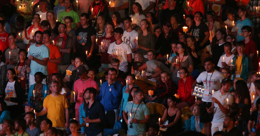 "World Youth Day pilgrims hold candles during a prayer vigil in 2016 with Pope Francis at the Field of Mercy in Krakow, Poland. ""Do not allow the spark of youth to be extinguished in the darkness of a closed room in which the only window to the outside world is a computer and smartphone,"" Pope Francis told youths in his annual message for local celebrations of World Youth Day."