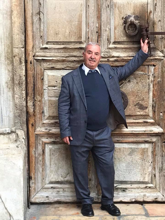Muslim doorkeeper Wajeeh Nuseibeh stands outside the closed Church of the Holy Sepulcher in Jerusalem's Old City. Nuseibeh closed and locked the doors Feb. 25 after heads of Christian churches in the Holy Land announced they were closing of the doors of the church for an undisclosed period of time.