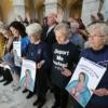 """Sisters of Mercy and others pray inside the Russell Senate Office Building in Washington Feb. 27 during a """"Catholic Day of Action for Dreamers"""" protest to press Congress to protect """"Dreamers."""""""