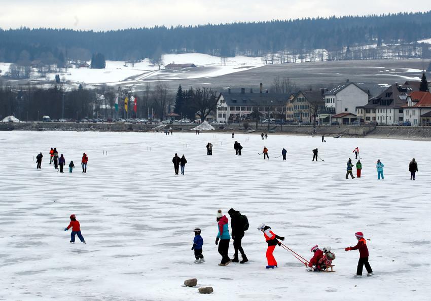 People walk on Lac de Joux in Le Pont, Switzerland, Feb. 28.