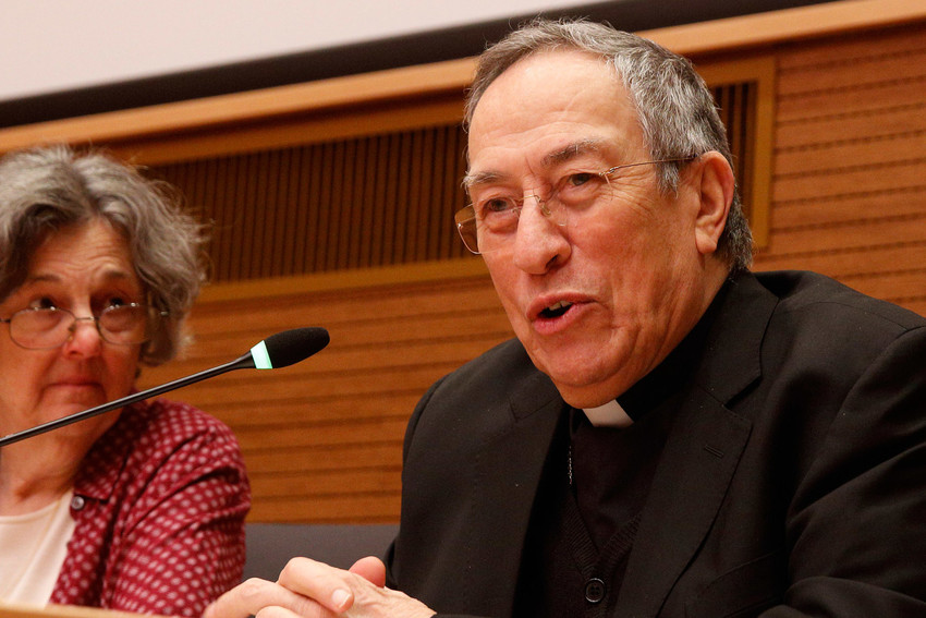"""Cardinal Oscar Rodriguez Maradiaga of Tegucigalpa, Honduras, speaks during the presentation of the book, """"A Pope Francis Lexicon,"""" in Rome March 1. Also pictured is Phyllis Zagano. During a question-and-answer session, Cardinal Rodriguez Maradiaga said that changes in the church are paving the way for more lay participation in church decisions."""
