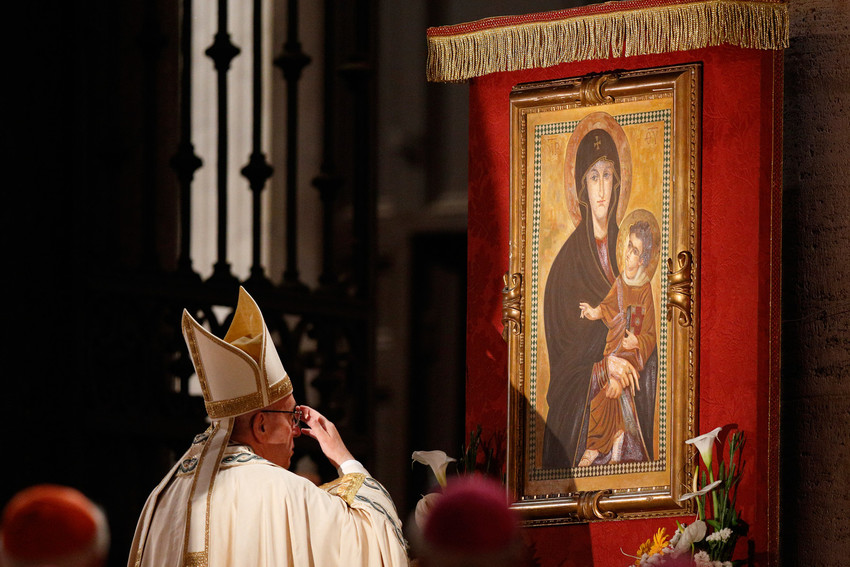 Pope Francis venerates a Marian image outside the Basilica of St. Mary Major in Rome in this May 26, 2016, file photo. The pope has instituted a new Marian feast honoring Mary as mother of the church. It will be celebrated every year on the Monday after Pentecost.
