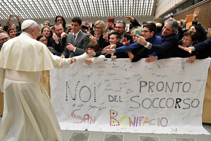 Pope Francis greets people during an audience with Italian nurses in Paul VI hall at the Vatican March 3.
