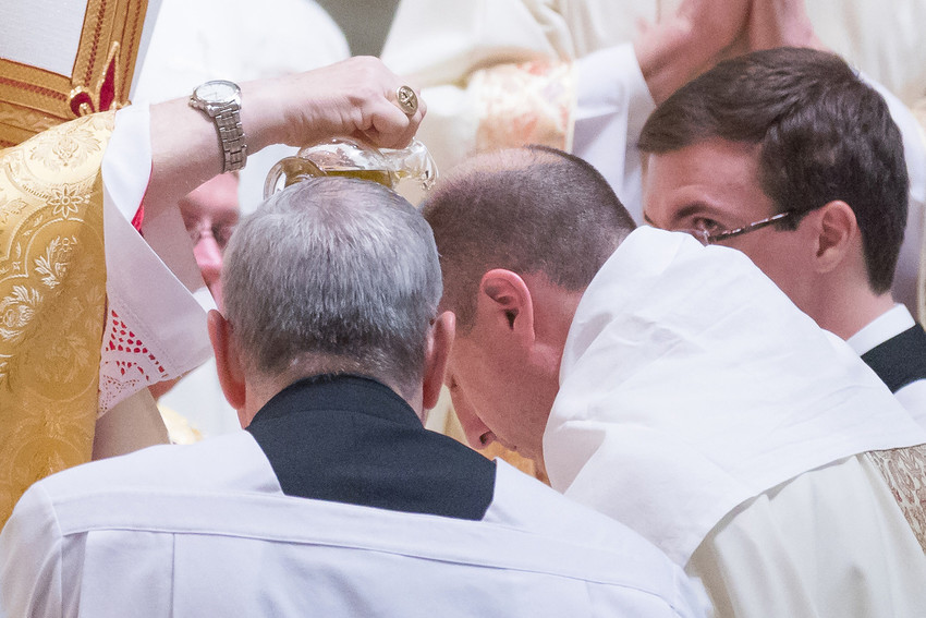 Archbishop Robert J. Carlson of St. Louis anoints Bishop W. Shawn McKnight with Oil of Chrism during Bishop McKnight's ordination and installation as bishop of the Jefferson City diocese on Feb. 6.