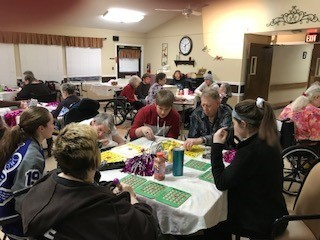 Confirmation candidates from Immaculate Conception parish visit a local nursing home in February as a service project in honor of newly ordained Bishop W. Shawn McKnight.