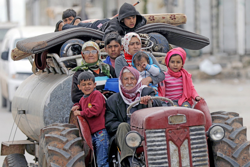 "Residents flee after Turkish-backed Free Syrian Army fighters captured the village of Khaldieh in Afrin, Syria. Christian activists warn that 1 million Syrian civilians will face certain slaughter in northwestern Afrin, where they allege Turkey and its militant allies have already carried out ""war crimes"" and ""ethnic cleansing."""