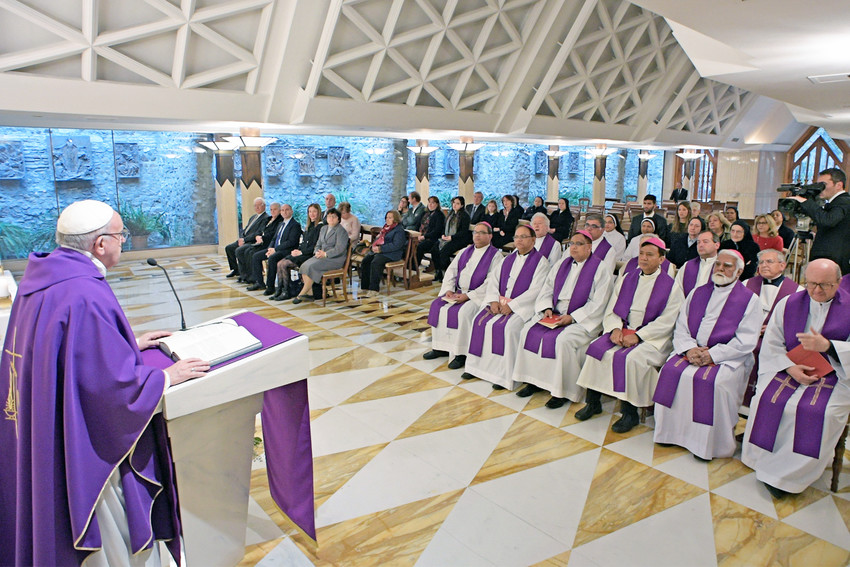 """Pope Francis gives the homily as he celebrates morning Mass in the chapel of the Domus Sanctae Marthae at the Vatican March 15. In his homily, the Pope said it takes more than one """"Hail Mary"""" to ask for God's help."""
