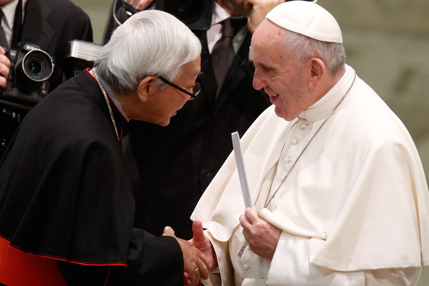 Pope Francis holds a letter presented by Cardinal Joseph Zen Ze-kiun, retired bishop of Hong Kong, during his general audience at the Vatican Jan. 10. Cardinal Zen says until the Vatican signs an agreement with China on the appointment of bishops, he will continue to speak against it.