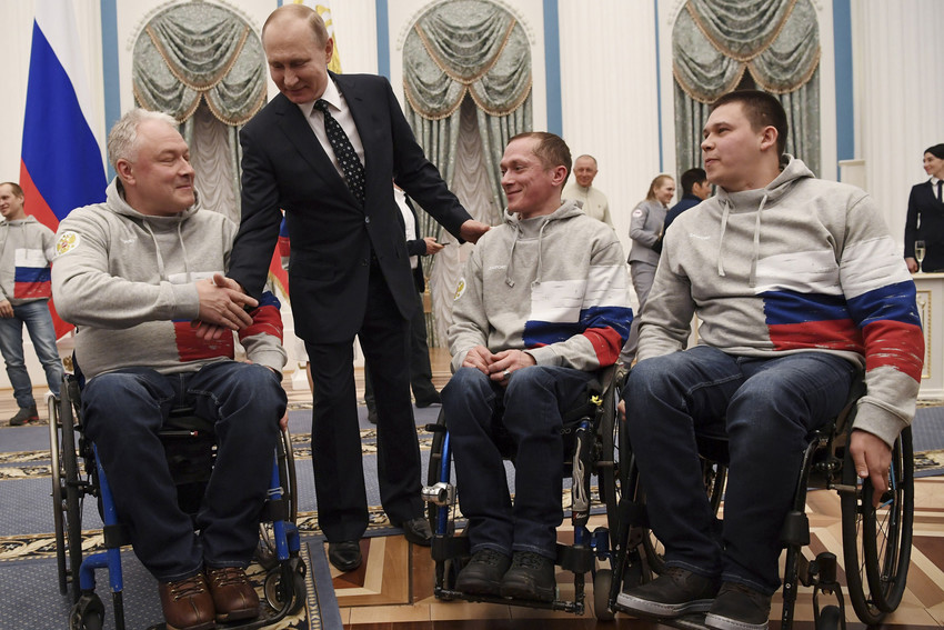 Russian President Vladimir Putin meets with medalists of the Pyeongchang 2018 Winter Paralympics after a ceremony at the Kremlin in Moscow. Putin will lead Russia for another six years, after securing an expected victory in the March 17 presidential election.