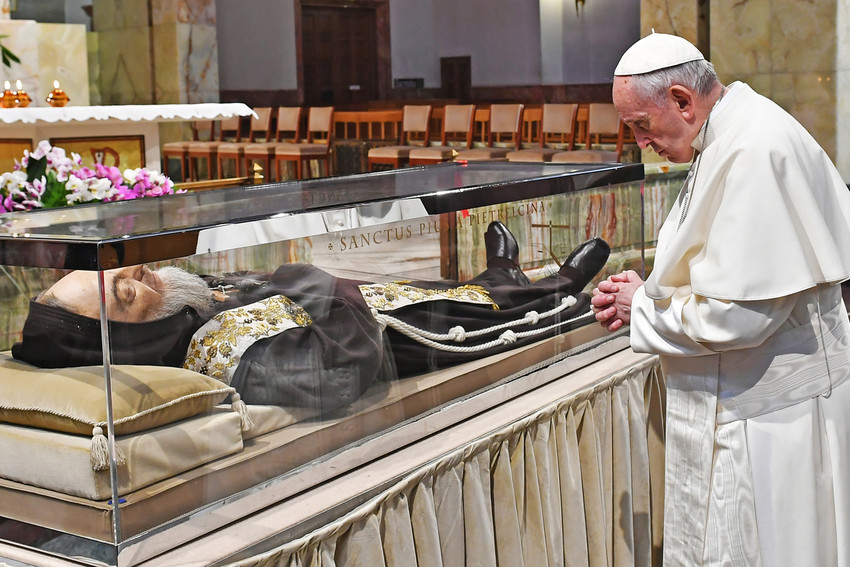 Pope Francis prays in front of the body of St. Pio in the Church of Santa Maria delle Grazie at the Shrine of St. Pio of Pietrelcina in San Giovanni Rotondo, Italy, March 17.