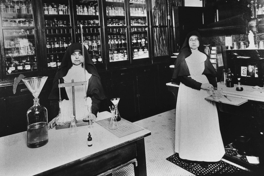 Two Sisters of St. Mary (later Franciscan Sisters of Mary) worked in the pharmacy at St. Mary's Infirmary in the 1900s. St. Mary's Infirmary was the first hospital opened by the congregation in 1887.