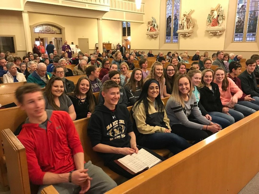 Nineteen high school students from St. Bonaventure parish in Marceline, Immaculate Conception parish in Brookfield and St. Mary of the Angels parish in Wien fill the front rows at Mass in Immaculate Conception Church before embarking on a lock-in event with food, fun and fellowship at St. Bonaventure.
