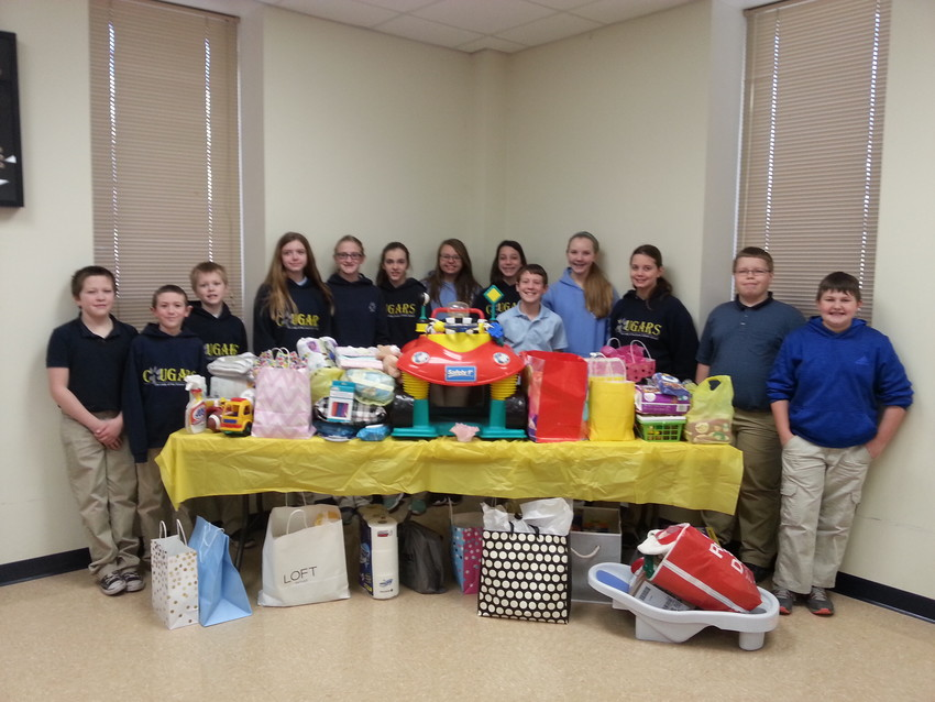 Members of the student council of Our Lady of Lourdes Interparish School in Columbia display the gifts they received at a baby shower they organized for the St. Raymond's Society, a comprehensive ministry for woman who are in crisis pregnancies, and their babies.