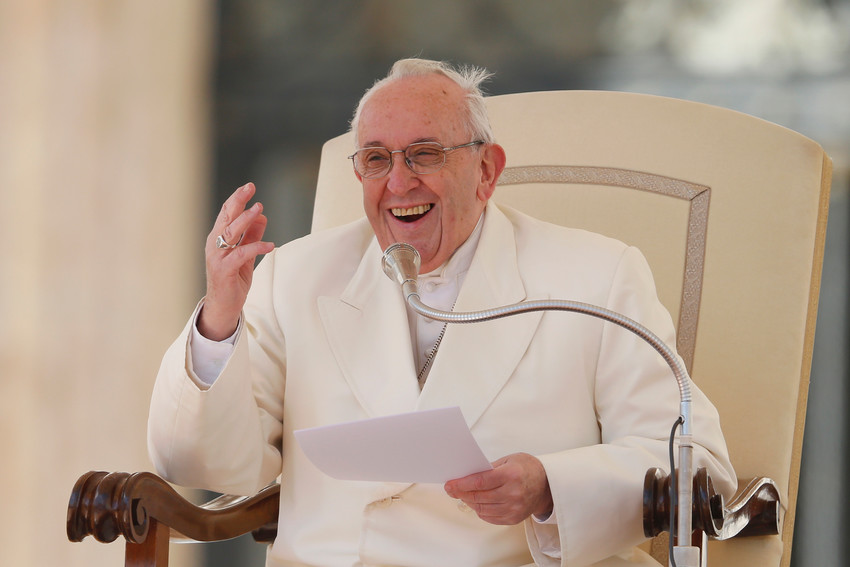 Pope Francis laughs after losing his zucchetto to a gust of window during his general audience in St. Peter's Square at the Vatican March 21. At the audience the pope confirmed that he will visit Ireland Aug. 25-26 for the final days of the World Meeting of Families.