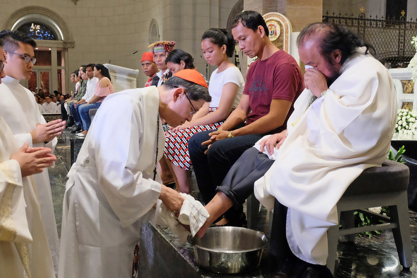Father Teresito Soganub, who had been held captive for months in Marawi, Philippines, cries as Cardinal Luis Antonio Tagle of Manila washes his feet during the Mass of the Lord's Supper March 29 in Manila. Father Soganub is vicar general of the prelature of Marawi.
