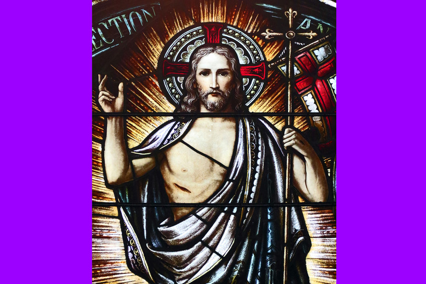 The risen Christ is depicted in a stained-glass window at St. Aloysius Church in Great Neck, New York